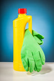 Rubber gloves colorful cleaning equipment and blue background Royalty Free Stock Images