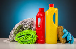 Rubber gloves colorful cleaning equipment and blue background Royalty Free Stock Photos