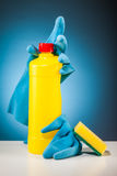 Rubber gloves colorful cleaning equipment and blue background Royalty Free Stock Photo