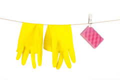Rubber gloves and a kitchen sponge hanging from a Royalty Free Stock Photography