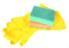 Rubber gloves and kitchen sponges Stock Photos