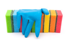 Rubber gloves and kitchen sponges Stock Image