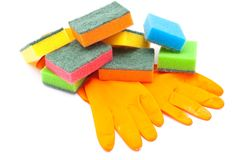 Rubber gloves and kitchen sponges Stock Photography