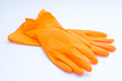 Rubber gloves. Orange rubber gloves closeup on a white background stock image