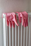 Rubber gloves on a radiator Stock Image