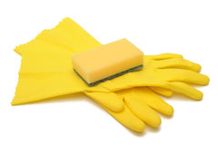 Rubber gloves and scourer. Photograph of a pair of yellow rubber gloves and a cleaning sponge Stock Photos