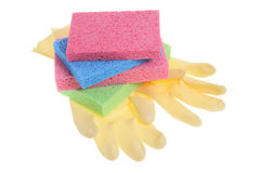 Rubber Gloves and Sponges Stock Images