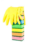 Rubber gloves on stacked kitchen sponges Royalty Free Stock Photo