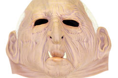 Rubber halloween mask on white Stock Image