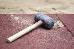Rubber hammer on brick pavement royalty free stock photos
