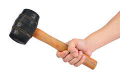 Rubber hammer in hand Stock Image