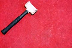 Rubber hammer on red carpet Stock Image