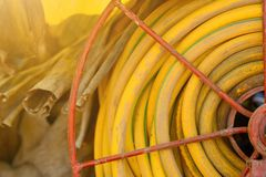Rubber hose for agriculture field. Royalty Free Stock Photography
