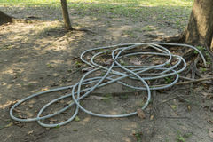 Rubber hose is kept on the ground. Stock Image