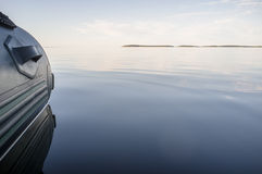 Rubber inflatable boat in calm sea Royalty Free Stock Photography