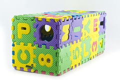 Rubber jigsaw puzzle box isolated. Stock Photography