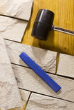 Rubber mallet and chisel Stock Images