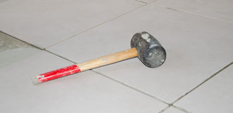 Rubber mallet on a floor tiling Royalty Free Stock Photography