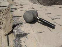 The Rubber Mallet lies on the newly laid granite paving stones Stock Image
