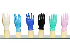 Rubber medical gloves of different colors isolated. On white background royalty free stock image