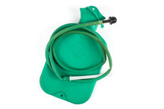 Rubber medical hot-water bottle filled with water. Green rubber medical hot-water bottle filled with water on a white background Stock Photography