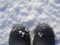 Rubber navy boots on snow Royalty Free Stock Photo