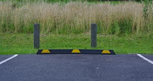 Rubber parking block in black and yellow colors stock photos