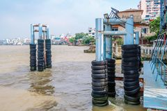 Old tires poles for protect  boats  bumper in the river. Rubber poles for protect  boats  bumper in the river Royalty Free Stock Photos