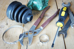 Rubber protective case and instruments lie on the wooden workbench in a garage Stock Photography