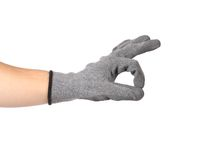 Rubber protective glove shows sign ok. Royalty Free Stock Photography
