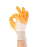 Rubber protective glove shows sign ok. Royalty Free Stock Image