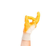Rubber protective glove shows sign ok. Stock Photo
