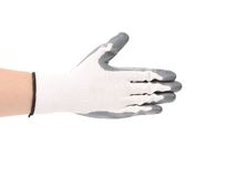 Rubber protective gray glove. Royalty Free Stock Photos
