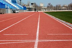 Rubber racetrack at stadium. Rubber racetrack at old small stadium Royalty Free Stock Photography
