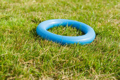 Rubber ring. Blue rubber ring on a grassy court. Ringo - traditional Polish game Stock Photography