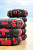 Rubber rings. Stack of rubber tires from a beach royalty free stock image