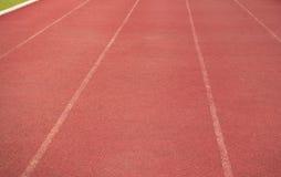 Rubber rinnande spår för stadion arkivbilder
