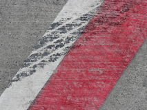 Rubber on road markings Stock Images