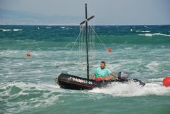 Rubber sailing boat in the turquoise waters of the Mediterranean sea Royalty Free Stock Image