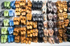 Rubber sandals on shop display in Key West, USA. Key West, USA-december 26. 2015 : Rubber sandals on shop display , shopping . Assortment of male and female Royalty Free Stock Photography