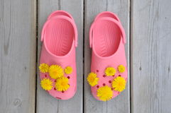 Rubber sandals with yellow flowers Royalty Free Stock Photos