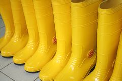 Rubber Shoes. Yellow rubber shoes / boots worn by industrial workers stock images