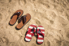 Rubber slippers on the beach Stock Images