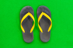 Rubber Slippers Placed on a green background Royalty Free Stock Images