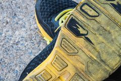 The rubber of the sneakers are deteriorated. Stock Photography