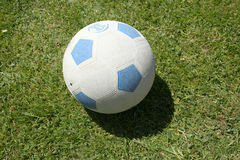 Rubber soccer ball. Closeup of rubber football or soccer ball on grass outdoors Royalty Free Stock Image