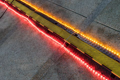Rubber speed bump with light on a road. Night time royalty free stock photos