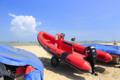 Rubber speedboats. Red rubber speedboat on the sand beach, amoy city, china Royalty Free Stock Photo