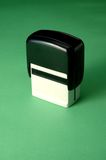 Rubber stamp. A rubber stamp on a green background Stock Photos