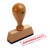 Rubber stamp approved. Rubber stamper with the word APPROVED printed in red royalty free stock images